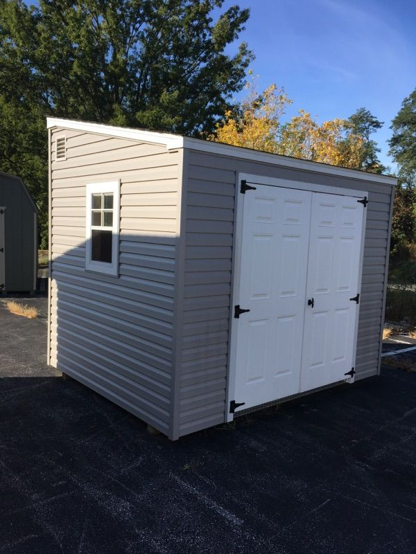 8x10 Lt. Gray vinyl Lean-To style with large 6' double door opening